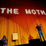 David Nihill, on stage at the 1,400 seater Castro Theatre in San Francisco at the Moth\'s largest storytelling Grandslam final.