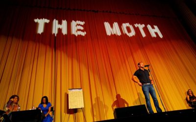David Nihill, on stage at the 1,400 seater Castro Theatre in San Francisco at the Moth's largest storytelling Grandslam final.
